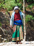 Nepalese woman carrying heavy load Royalty Free Stock Photo