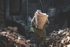A nepalese woman carrying some load Royalty Free Stock Images
