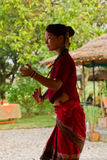 Nepalese woman dancing traditional dance in Chitwan, Nepal Stock Photos