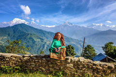 Nepalese woman in front of her home in the Himalayas mountains Stock Photo