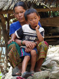 Nepalese woman having child on her lap Stock Photo