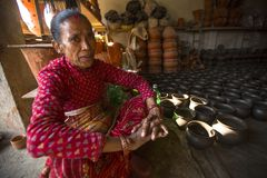 Nepalese woman in the his pottery workshop. Stock Photo