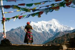 Nepalese woman and Langtang peak Stock Images