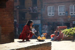 Nepalese woman making ritual fire in Bhaktapur Royalty Free Stock Image
