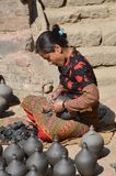 Nepalese woman in pottery Royalty Free Stock Photo