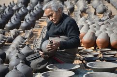 Nepalese woman in pottery Royalty Free Stock Photography