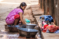 Nepalese Woman Washing Clothes, Bhaktapur, Nepal Stock Photography