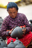Nepalese woman working in the her pottery workshop Royalty Free Stock Images