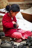 Nepalese woman working in the her pottery workshop Stock Photo