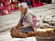 Nepalese woman working in the her pottery workshop Royalty Free Stock Image