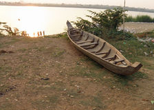 Wooden boat on Mekong river in Cambodia. A handmade wooden boat beached on the Mekong river bank in Cambodia Royalty Free Stock Photography