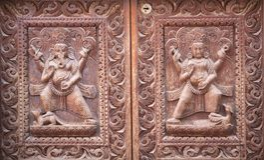 Nepalese wooden carving with Ganesha and Kartikeya Hindu Gods. At the temple in Patan, Kathmandu valley, Nepal. Kartikeya, also known as Murugan, Skanda, Kumara royalty free stock images