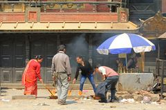 Nepalese worshipers giving religious offerings in Nepal Stock Images