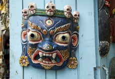 Nepalesisk demonmaskering Arkivbild