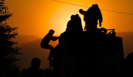 Nepali bus riders at sunset Stock Photography