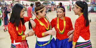 Nepali girls in traditional attire having fun. Gandhinagar, India - March 9, 2018: Group of Sikkim girls from Nepalese community dressed in traditional attire royalty free stock photography