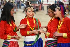 Nepali girls in traditional costume. Gandhinagar, India - March 9, 2018: Sikkim folk dancer girls from Nepalese community dressed in traditional costume and Royalty Free Stock Image