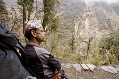 Nepali guide resting on the way to abc Stock Images