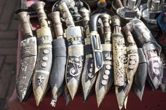 Nepali knife khukuri with wooden scabbard in a row for sale Stock Photography