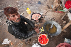 Nepali man cooking snacks, Bardia, Nepal Stock Images