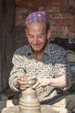 Nepali man enjoying his pottery work Stock Photos