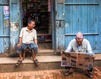 Nepali man reading newspaper stock images