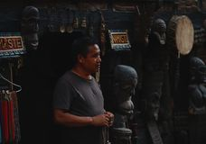 Nepali Man Selling Traditional Wooden Statue at Thamel Street. Editorial Royalty Free Stock Photos