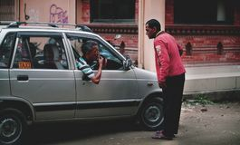 Nepali Man Talking to Taxi Driver At Thamel Street. Editorial Royalty Free Stock Photography