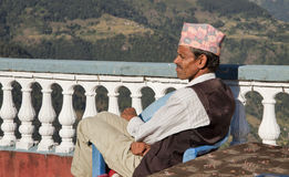 Nepali men resting before hike Royalty Free Stock Image