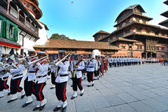 Nepali musicians marching. KATHMANDU - OCT 11: Musicians of the Nepali Military Orchestra marching in the inner courtyard of the Royal Palace, during the Dasain Stock Photos