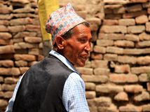A Nepali old man wearing a traditional cap Stock Images