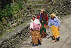 Nepali people in a small village. Nepali people with traditional clothing in the small village along the Annapurna ridge in Nepal Stock Photography