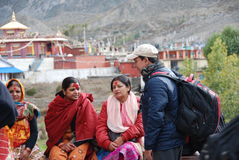 Nepali people and a temple in the background Stock Photography