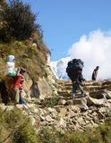 Nepali porters in the Everest trail Royalty Free Stock Photos