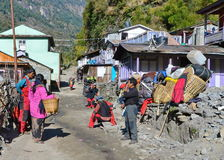 Nepali porters taking a rest Royalty Free Stock Photography