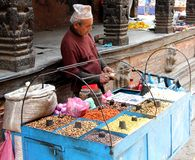A Nepali street hawker selling snacks Royalty Free Stock Images