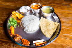 Nepali Thali meal set with curry chicken Stock Photos