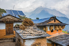 Nepali traditional houses with solar cell panel on the roof. Stock Images