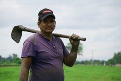 Chitwan Nepal July 20 2020 : Nepali village man  working in the farmland from Chitwan Nepal