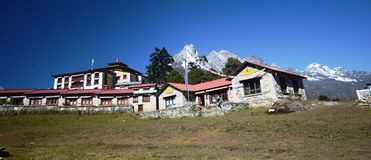 Nepali village of Tengboche. With the monastery and snow mountains in the background Stock Photo