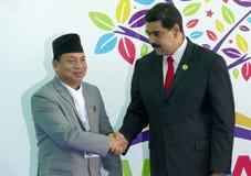 Nepali-Vizepräsident Nanda Bahadur Pun und venezolanischer Präsident Nicolas Maduro Lizenzfreies Stockfoto