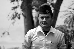 A Nepali waiter/man wearing a traditional cap Royalty Free Stock Photo