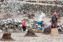 Nepali woman and children in field working. Everest region, Hima Stock Photography