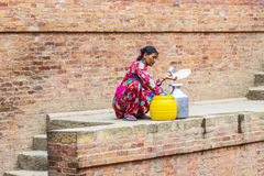 Nepali woman fills up the water Royalty Free Stock Image