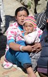 Nepali woman and her baby Royalty Free Stock Photography