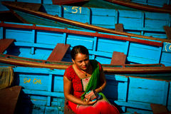 A Nepali woman sitting in the boats of Phewa Lake, Pokhara, Nepal Stock Photos