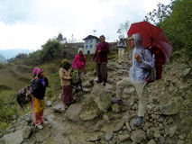 Nepalis have met on the trail in the mountains of the Himalayas. Royalty Free Stock Photography