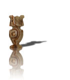 Nephrite statuette of owl. Nephrite statuette with shadow of owl Stock Image
