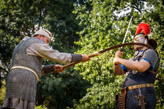 NEPTUN, ROMANIA - JULY 28, 2015 - Ancient Festival - Reenactment. Of the Roman and  Dacian (Thracian) wars - Roman centurion fighting a Dacian soldier with a Royalty Free Stock Image