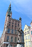 Neptune with ball. Famous fountain of the Neptune with the ball, against town hall in old Gdansk - the host of the Euro 2012 Royalty Free Stock Images
